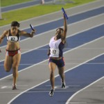 Tracy Joseph (right) takes the victory for her team after running the end of the 4x100 metres relay during the 2010 Central American Games held in Panama.
