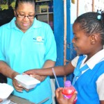 Kamisha Hall, student at the Priory Primary and Infant School receives a hot meal from Rachel Pyne, director for community services in North Jamaica on Oct. 17, 2012. Nearly 200 students benefitted from the school feeding program during the special Week of Generosity held Oct. 11-17, in North Jamaica. Images by Dyhann Buddoo-Fletcher.