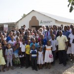 Maranatha leaders and church members pose for a picture in front of the newly completed Luz de Javilla Adventist Church located in Santo Domingo, Dominican Republic. Previously, members were meeting in a patio-like structure, with a rusting metal roof, termite-infested rafters, and paper tarp walls. The new church is one of four churches dedicated Sep. 4-5, 2015. Image by Yuma Molina/MVI