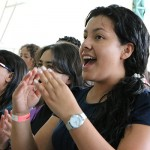 University students participate in song service during the three-day event held in South Colombia.