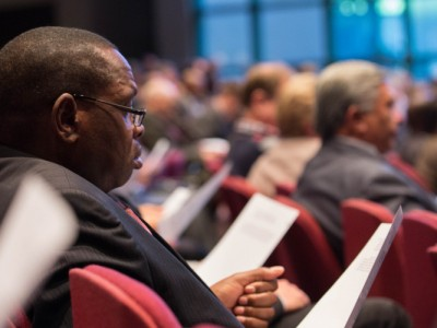 Annual Council attendees reading handouts of an appeal to church leaders and the world church Sunday, Oct. 11. Image by Brent Hardinge / ANN
