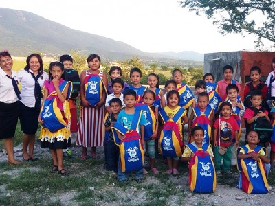 Children pose with their new backpacks full of school supplies in one of the dozens of communities in south central Mexico in the church's Inter-Oceanic Mexican Union territory in Puebla, in late August, 2015. Images courtesy of Inter-Oceanic Mexican Union