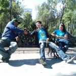Joel Omana (center) youth leader of the Narvarte Adventist Church shakes hands with a man at the park during the youth event in Mexico City, on Oct. 10, 2015. Nearly 200 Adventist youth took to the streets to spread cheer and hope. Images courtesy by Narvarte Adventist Church.
