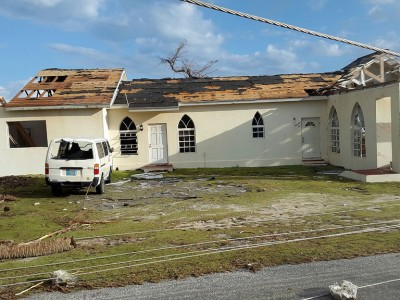 The damaged Landrill Point Seventh-day Adventist Church in Crooked Island with adjacent pastor's residence after Hurricane Joaquin slammed into the southeastern Bahamas region Oct. 1-2, 2015. Image by Alvarico Moss/ATCU
