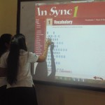 High school seniors take part on the new digital boards in class at the Adventist School in Managua, Nicaragua, Image provided by COVANIC