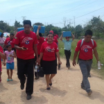 Youth in Chiapas, Mexico carry food boxes to needy communities. Image from Facebook