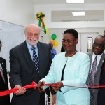 Haiti's First Lady Ginnette Michaud Privert (center) cuts the ribbon to inaugurate the new state-of-the-art surgical suite at Hopital Adventist d'Haiti next to (from left to right) Pierre Caporal, president of the church in Haiti, Richard Hart, president of Loma Linda University, Elie S. Honore, President of Adventist Health Services Inter-America and Fritz Bisseret, ADRA Haiti director. mages by Libna Stevens/IAD