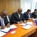From left to right: Elie Honore, AHS-Inter-America president, Pastor Israel Leito, IAD president,  Gene Thompson, Health City Cayman Islands Director, and Chandy Abraham, Health City Cayman Islands CEO, sign the Memorandum of Understanding between HCCI and AHS-Inter-America, on Apr. 18, 2016, in Miami, Florida, United States. Image by Libna Stevens/IAD