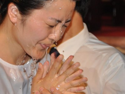 A woman being baptized in China, one of the countries mentioned in the new U.S. report. Image by Gary Krause / PARL