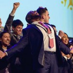 La Sierra University's Enactus team celebrating on stage after being declared champions. Image by Otto Mejia/Enactus USA/LSU