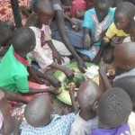 Children sharing a meal in safety at the Adventist compound in Juba, South Sudan. Image Cliff Momanyi / ADRA / Facebook