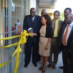 Collette Roberts Risden, permanent secretary in the Ministry of Labor and Social Security and Pastor Israel Leito, president of the church in Inter-America cut the ribbon to officially open the new health center of the Good Samaritan Inn, in Kingston, Jamaica, June 30, 2016. Looking on are: (L-R) Pastor Everett Brown, president of the Adventist Church in Jamaica (partly hidden), Commander John McFarlane, Acting Custos of St. Andrew, Mr. Cecil Foster, President of ASi East Jamaica Conference Chapter, Pastor Eric Nathan, president of East Jamaica  and Pastor Leon Wellington, vice president of the church in Inter-America. Images by Nigel Coke