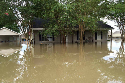 One of 30,000 homes flooded on Aug. 14, 2016, in the US state of Louisiana. ACS DR is helping recovery efforts in the state. Image by Sherry Watts