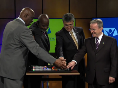 From left to right: IAD administrators Pastors Israel Leito, Elie Henry, Filiberto Verduzco and Hope Channel's President Derek Morris, place their right hand on a switch symbolizing the satellite airing of Hope Channel Inter-America, during a launch program held at the IAD Headquarters in Miami, Florida, United States, September 15, 2016.  Image by IAD