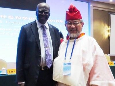 Ganoune Diop (Left) standing with Rt. Rev. Yoshinobu Miyake (Right) from the Konko Church of Izuo (Shinto), Japan, during the G20 Interfaith Summit in Hangzhou, China. The Summit allowed religious leaders to consider how religion can help foster international dialogue and problem-solving. [Photo courtesy of Ganoune Diop]