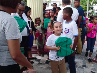Children received a backpack full of school supplies. Image by ADRA Dominican Republic