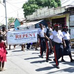 Members of the Jamaica Constabulary Force march for peace with Adventist leaders and church members during a special Day of Kindness and Generosity Day in West Kingston, on Oct. 8, 2016. Images by Phillip Castell/EJC